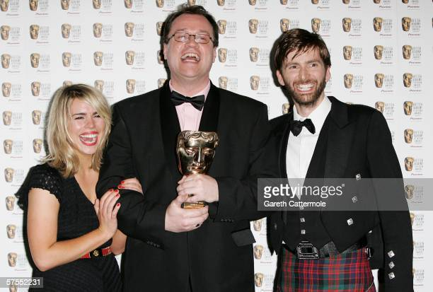 Billie Piper and David Tennant pose in the Awards Room with Russell T. Davis who won the Dennis Potter Award for Television Writing at the Pioneer...