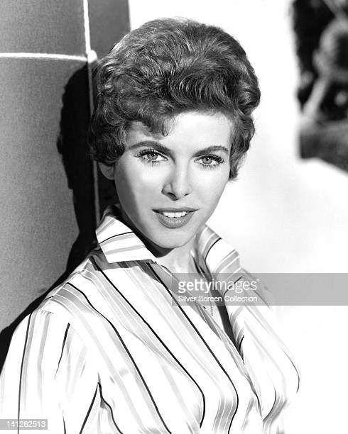 Billie Whitelaw, British actress, wearing a striped blouse, posing against a tiled surface, circa 1955.