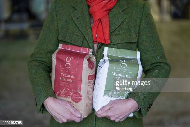 Billie Wilkinson, owner of Gilchesters Organics, with packaged products at their flour mill in Stamfordham, U.K., on Monday, Nov. 30, 2020. The mill...