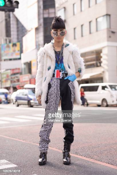 Billimayu is seen wearing white fur coat black/white dalmation print pants and blue glove during the Amazon Fashion Week TOKYO 2019 S/S on October 20...