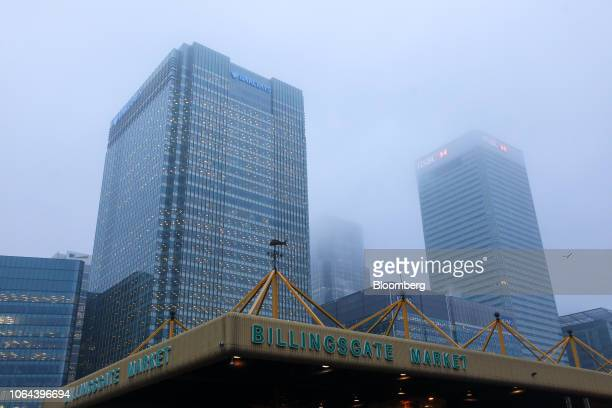 Billingsgate Fish Market stands in front of the Barclays Plc and the HSBC Holdings Plc headquarter buildings in the Canary Wharf financial business...