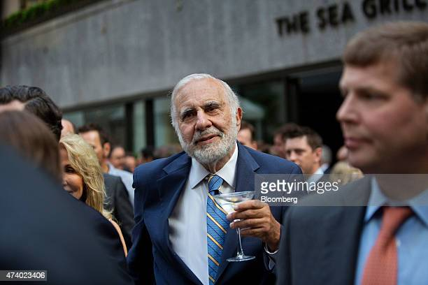 Billionaire activist investor Carl Icahn holds a martini glass while attending the Leveraged Finance Fights Melanoma charity event in New York US on...