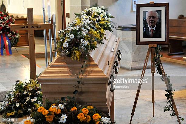 Billionaire Adolf Merckle's coffin sits next to his photograph prior to his memorial service in Blaubeuren Germany on Monday Jan 12 2009 Family and...