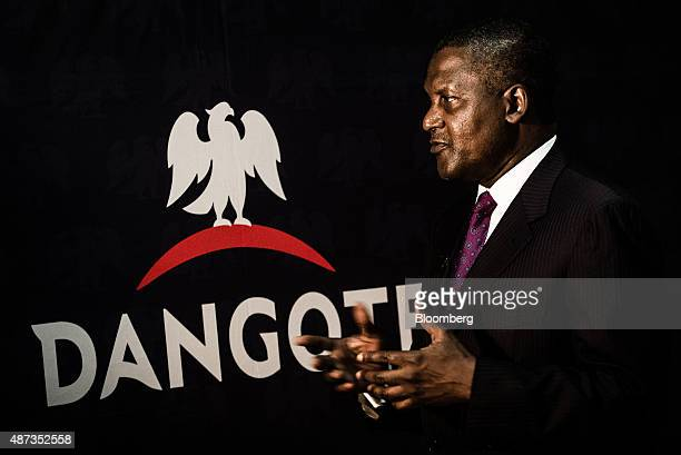 Billionaire Aliko Dangote chief executive officer of Dangote Group gestures after signing a factory construction contract with Sinoma International...