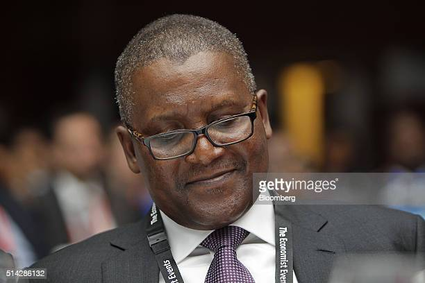 Billionaire Aliko Dangote president and chief executive officer of Dangote Group takes part in The Economist Nigeria Summit in Lagos Nigeria on...