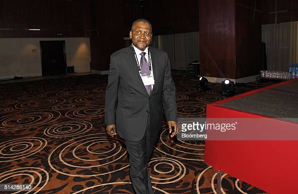 Billionaire Aliko Dangote president and chief executive officer of Dangote Group arrives at The Economist Nigeria Summit in Lagos Nigeria on Monday...