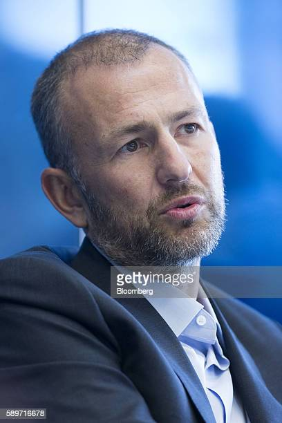 Billionaire Andrey Melnichenko owner of EuroChem Group AG speaks during a meeting in London UK on Monday Aug 15 2016 EuroChem Group AGs new mines in...
