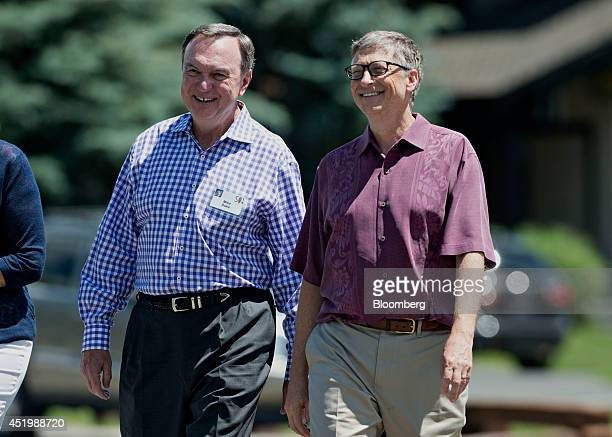Billionaire Bill Gates chairman and founder of Microsoft Corp right talks with Mike Duke chairman of the WalMart Stores Inc executive committee and...
