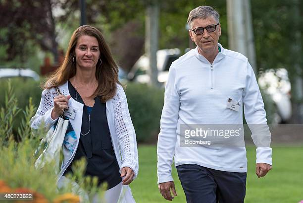 Billionaire Bill Gates chairman and founder of Microsoft Corp right and his wife Melinda Gates arrive for a morning session during the Allen Co Media...