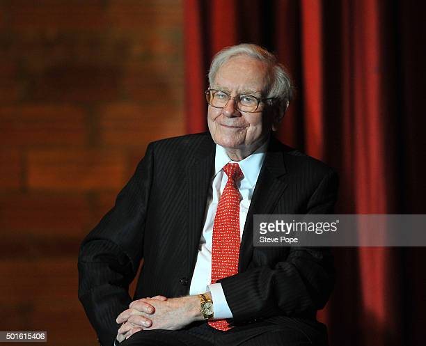 Billionaire Businessman Warren Buffett listens to Democratic Presidential Candidate Hillary Rodham Clinton at a Town Hall rally at Sokol Auditorium...