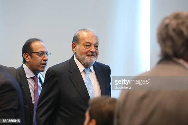 Billionaire Carlos Slim chairman emeritus of America Movil SAB and Telefonos de Mexico SAB center arrives followed by his son Marco Antonio Slim...