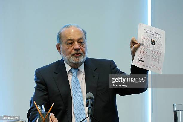 Billionaire Carlos Slim chairman emeritus of America Movil SAB and Telefonos de Mexico SAB speaks while holding up a copy of 'Donald Trump's Contract...