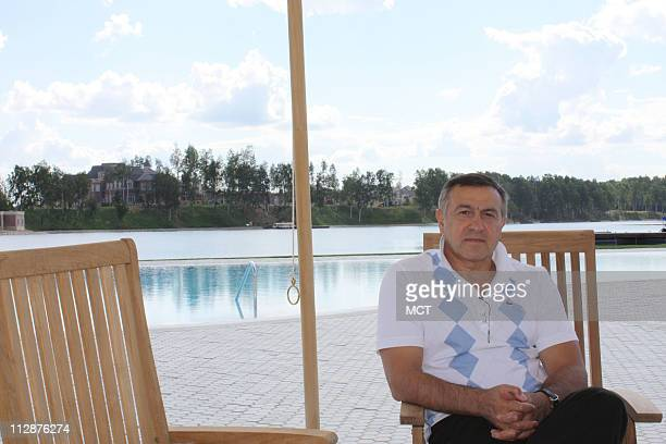 Billionaire developer Aras Agalarov sits in front of a swimming pool which abuts a small lake at his new real estate development outside of Moscow...