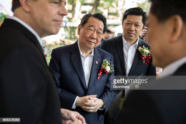 Billionaire Dhanin Chearavanont chairman of Charoen Pokphand Group center and his son Suphachai Chearavanont chief executive officer center right...