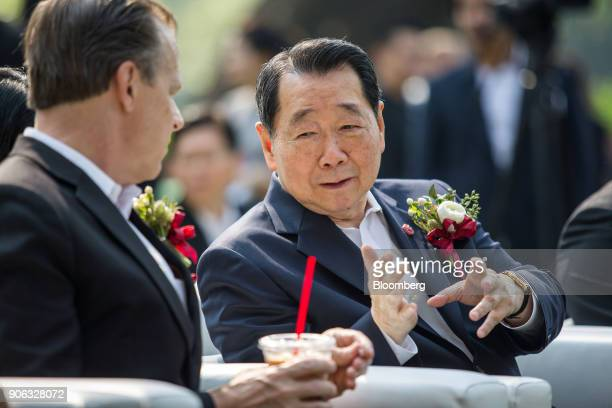 Billionaire Dhanin Chearavanont chairman of Charoen Pokphand Group right speaks to Glyn Townsend Davies US ambassador to the Kingdom of Thailand at a...