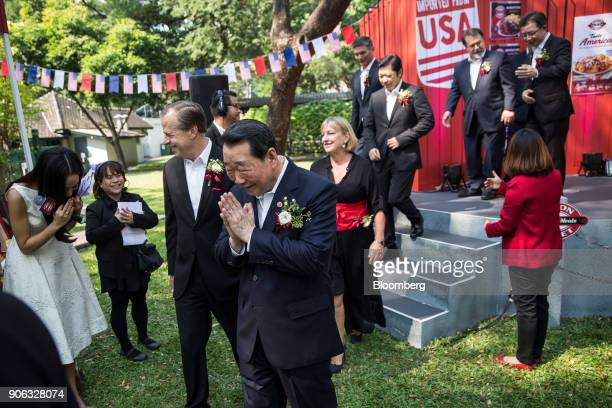 Billionaire Dhanin Chearavanont chairman of Charoen Pokphand Group center and Glyn Townsend Davies US ambassador to the Kingdom of Thailand center...