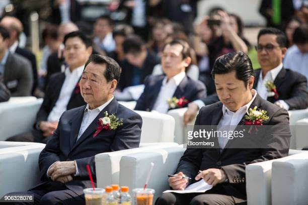 Billionaire Dhanin Chearavanont chairman of Charoen Pokphand Group left and his son Suphachai Chearavanont chief executive officer attend a news...