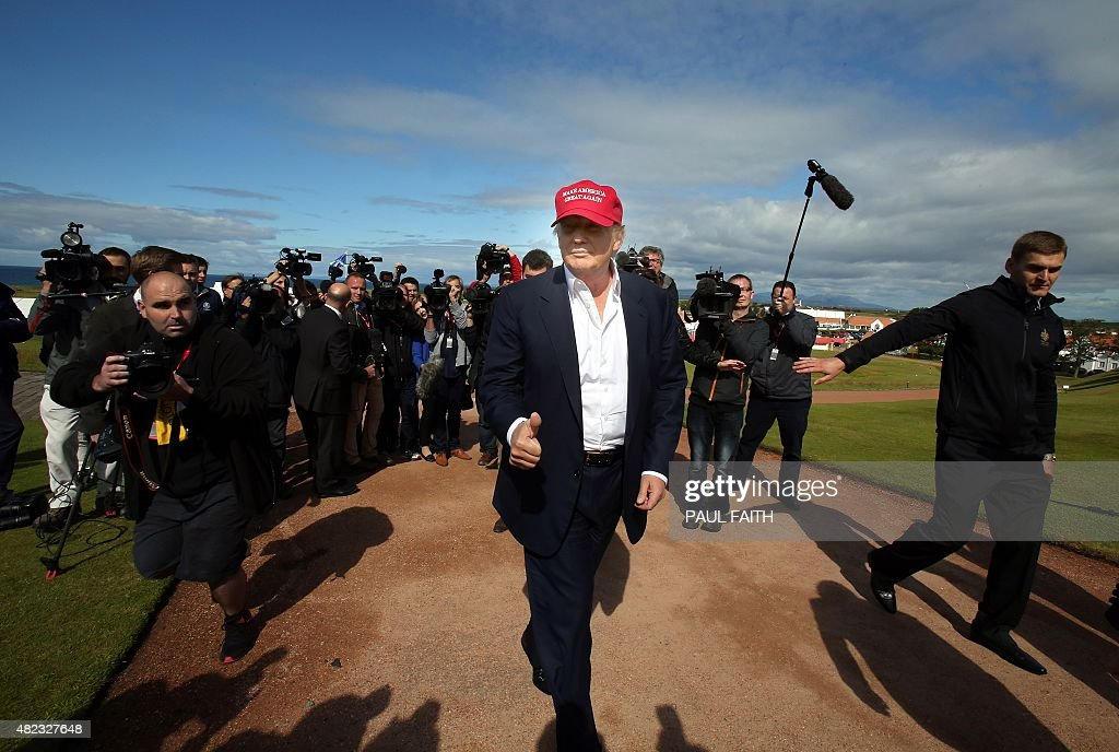 US billionaire Donald Trump (C) is pictured as he arrives at the Women's British Open Golf Championships in Turnberry, Scotland, on July 30, 2015.