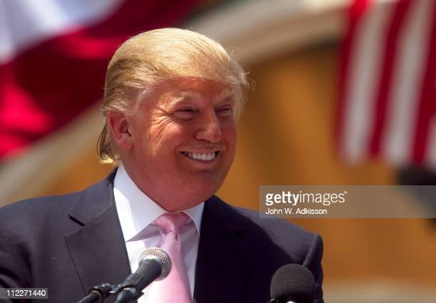 Billionaire Donald Trump laughs while speaking to a crowd at the 2011 Palm Beach County Tax Day Tea Party on April 16 2011 at Sanborn Square in Boca...