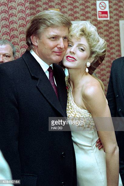 US billionaire Donald Trump poses on April 7 1993 with Marla Maples as they confirm published reports that the actress is pregnant with his child The...