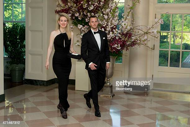 Billionaire Elizabeth Holmes founder and chief executive officer of Theranos Inc left and Christian Holmes arrive at a state dinner hosted by US...