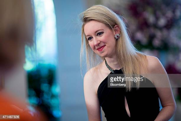 Billionaire Elizabeth Holmes founder and chief executive officer of Theranos Inc speaks to the media as she arrives at a state dinner hosted by US...