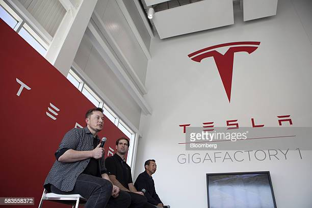 Billionaire Elon Musk, chief executive officer of Tesla Motors Inc., left, speaks as Jeffrey Straubel, chief technical officer and co-founder of...