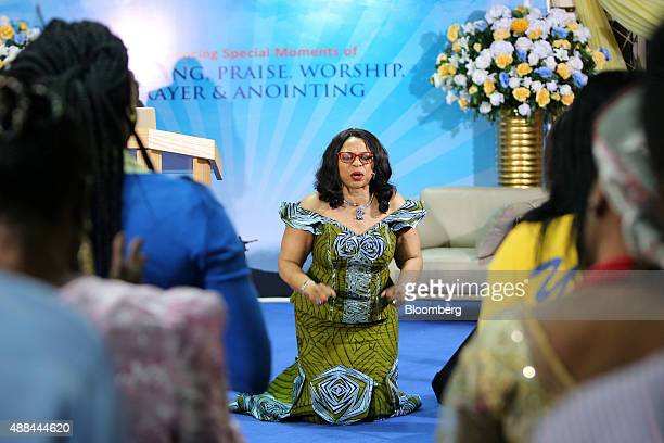 Billionaire Folorunso Alakija Nigeria's richest woman prays on stage to the congregation of the Rose of Sharon Glorious Ministry in Lagos Nigeria on...