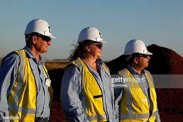 Billionaire Gina Rinehart chairman of Hancock Prospecting Ltd center stands with Barry Fitzgerald chief executive officer of Roy Hill Mine left and...