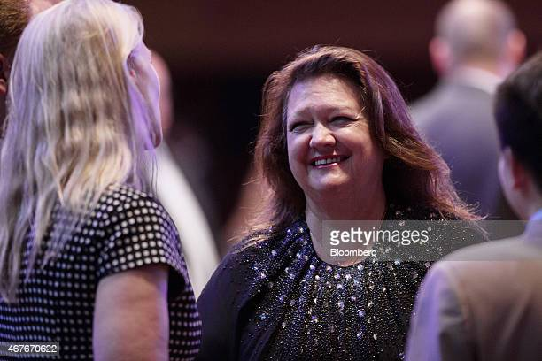 Billionaire Gina Rinehart chairman of Hancock Prospecting Pty center speaks with attendees during the Mines and Money conference in Hong Kong China...