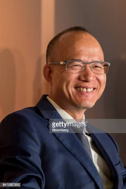 Billionaire Guo Guangchang chairman and cofounder of Fosun International Ltd speaks during a news conference in Hong Kong China on Thursday Aug 31...