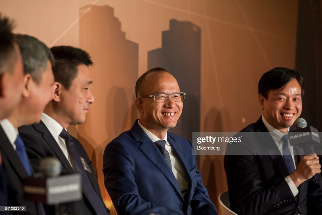 Billionaire Guo Guangchang, chairman and co-founder of Fosun International Ltd., second right, reacts as Wang Qunbin, chief executive officer, right, speaks during a news conference in Hong Kong, China, on Thursday, Aug. 31, 2017. Fosun the listed flagship ofGuo's insurance-to-drugs conglomerate, reported first-half net income increased 34 percent amid higher returns from investments. Photographer: Paul Yeung/Bloomberg via Getty Images