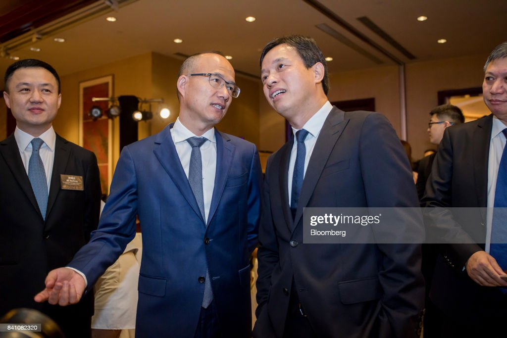 Billionaire Guo Guangchang, chairman and co-founder of Fosun International Ltd., left, speaks with Wang Qunbin, chief executive officer, ahead of a news conference in Hong Kong, China, on Thursday, Aug. 31, 2017. Fosun the listed flagship ofGuo's insurance-to-drugs conglomerate, reported first-half net income increased 34 percent amid higher returns from investments. Photographer: Paul Yeung/Bloomberg via Getty Images