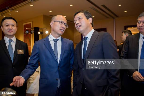 Billionaire Guo Guangchang chairman and cofounder of Fosun International Ltd left speaks with Wang Qunbin chief executive officer ahead of a news...