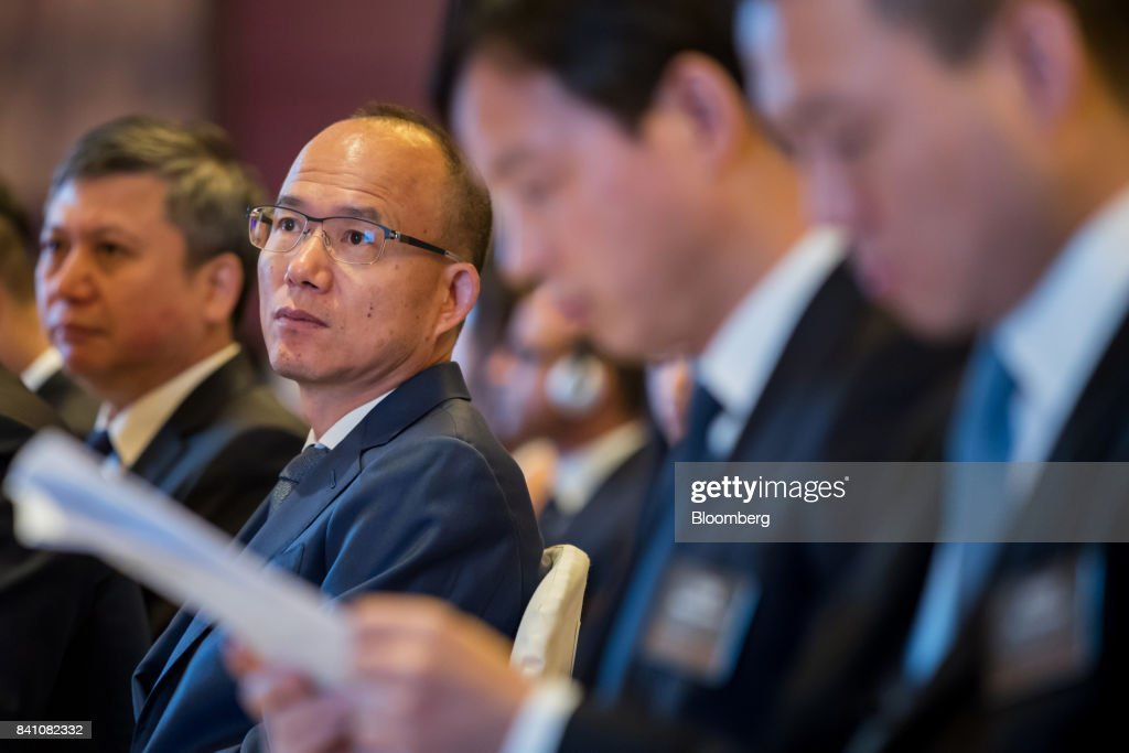 Billionaire Guo Guangchang, chairman and co-founder of Fosun International Ltd., second left, attends a news conference in Hong Kong, China, on Thursday, Aug. 31, 2017. Fosun the listed flagship ofGuo's insurance-to-drugs conglomerate, reported first-half net income increased 34 percent amid higher returns from investments. Photographer: Paul Yeung/Bloomberg via Getty Images