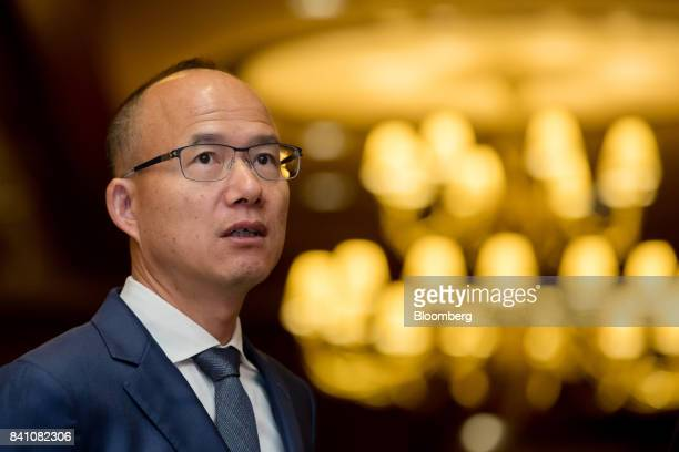 Billionaire Guo Guangchang chairman and cofounder of Fosun International Ltd looks on ahead of a news conference in Hong Kong China on Thursday Aug...