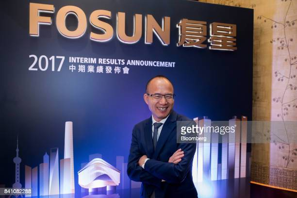 Billionaire Guo Guangchang chairman and cofounder of Fosun International Ltd poses for a photograph ahead of a news conference in Hong Kong China on...
