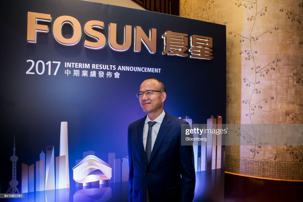 Billionaire Guo Guangchang, chairman and co-founder of Fosun International Ltd., poses for a photograph ahead of a news conference in Hong Kong, China, on Thursday, Aug. 31, 2017. Fosun the listed flagship ofGuo's insurance-to-drugs conglomerate, reported first-half net income increased 34 percent amid higher returns from investments. Photographer: Paul Yeung/Bloomberg via Getty Images