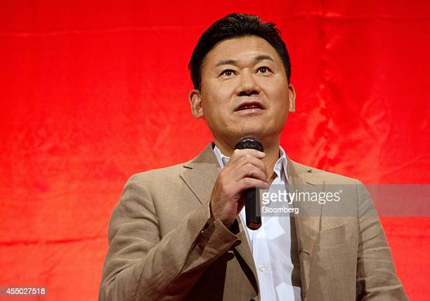 Billionaire Hiroshi Mikitani chairman and chief executive officer of Rakuten Inc speaks during a news conference in Tokyo Japan on Tuesday Sept 9...