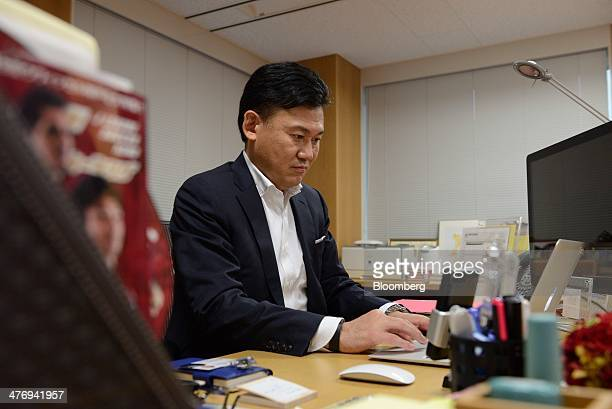 Billionaire Hiroshi Mikitani chairman and chief executive officer of Rakuten Inc types on a keyboard for a photograph following an interview in Tokyo...
