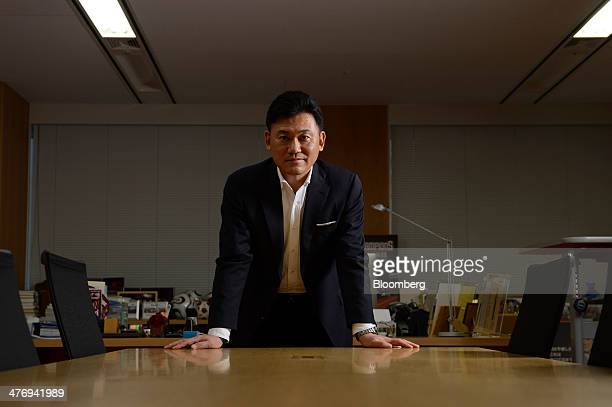Billionaire Hiroshi Mikitani, chairman and chief executive officer of Rakuten Inc., poses for a photograph following an interview in Tokyo, Japan, on...