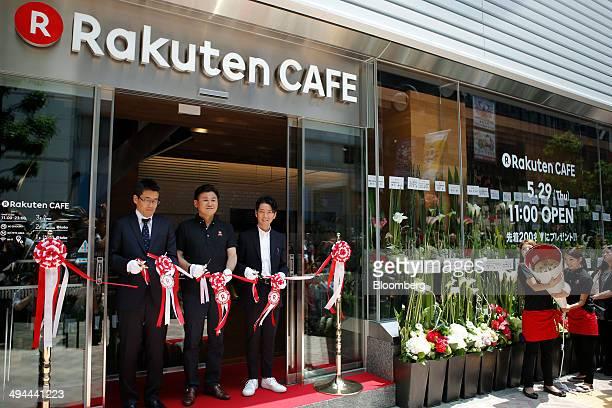 Billionaire Hiroshi Mikitani chairman and chief executive officer of Rakuten Inc center Kenichiro Nakajima chief marketing officer of Rakuten Inc...