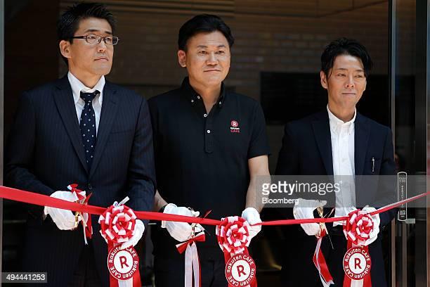 Billionaire Hiroshi Mikitani chairman and chief executive officer of Rakuten Inc center poses for a photograph with Kenichiro Nakajima chief...