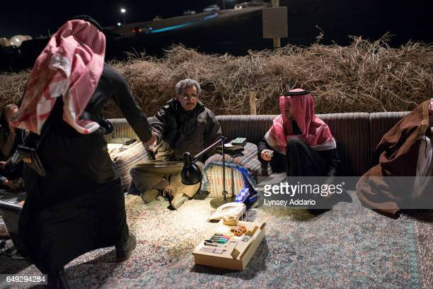 Billionaire HRH Prince Waleed bin Talal greets Saudi citizens at a desert camp outside of Riyadh to accept their petitions for his help Saudi Arabia...