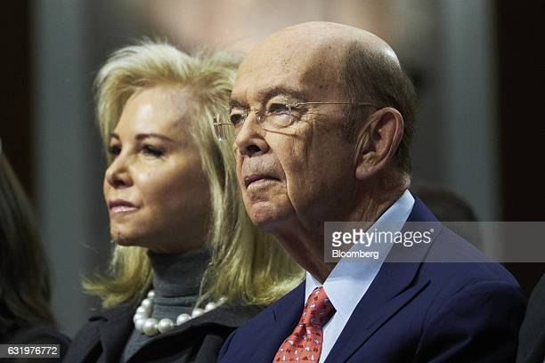 Billionaire investor Wilbur Ross commerce secretary nominee for US Presidentelect Donald Trump right and his wife Hilary Geary listen during a Senate...