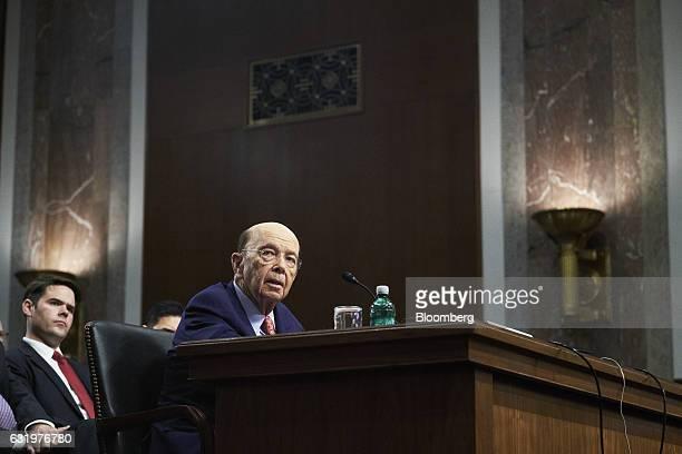 Billionaire investor Wilbur Ross commerce secretary nominee for US Presidentelect Donald Trump speaks during a Senate Commerce Science and...