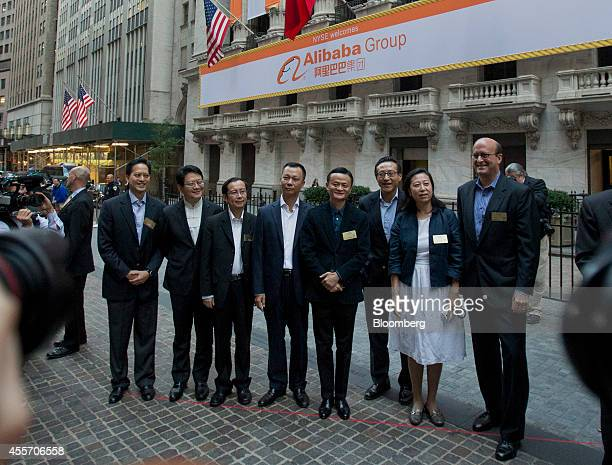 Billionaire Jack Ma chairman of Alibaba Group Holding Ltd fourth right stand for a photograph with Peng Jiang deputy chief technology officer of...