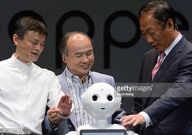 Billionaire Jack Ma chairman of Alibaba Group Holding Ltd left billionaire Masayoshi Son chairman and chief executive officer of SoftBank Corp center...