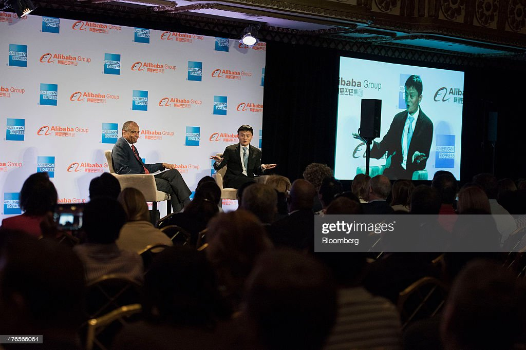 Billionaire Jack Ma, chairman of Alibaba Group Holding Ltd., speaks with Kenneth 'Ken' Chenault, chairman and chief executive officer of American Express Co., left, during an event in Chicago, Illinois, U.S., on Wednesday, June 10, 2015. Alibaba Group Holding Ltd.'s entry into the U.S. runs through small businesses, the same path the online marketplace took in China, Ma said. Photographer: Daniel Acker/Bloomberg via Getty Images