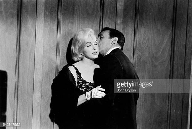 Billionaire JeanMarc Clement kisses Amanda Dell in the film Let's Make Love Released in 1960